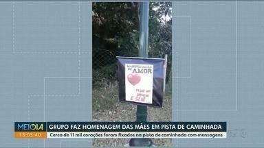 Grupo faz homenagem para as mães em pista de caminhada em Cianorte - Cerca de 11 mil corações foram fixados no local.