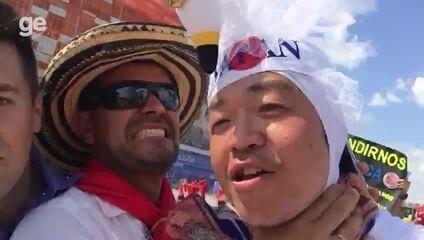 Torcidas de Colômbia e Japão se divertem antes do jogo e brincam com repórter