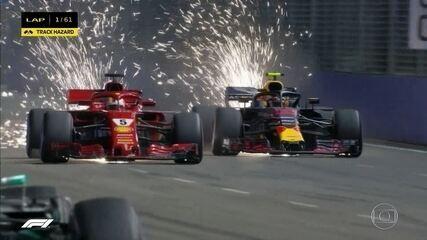 Largada do GP de Cingapura tem batida entre companheiros e Vettel ganhando posição