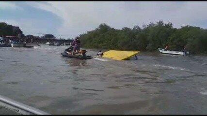 Pescadores montam 'operação' para resgatar barcos submersos após ciclone bomba; veja