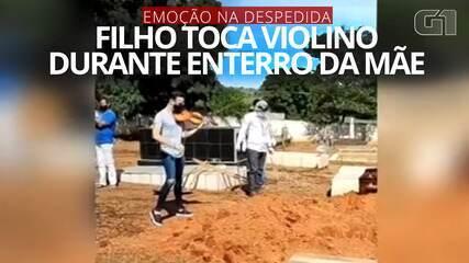 VÍDEO: Filho emociona ao tocar violino no enterro da mãe em cemitério de Goiás