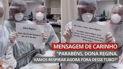 Equipe médica usa cartazes para informar paciente com Covid-19 que ela será extubada
