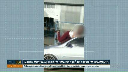 Imagem mostra mulher em cima de capô de carro em movimento, em Francisco Beltrão