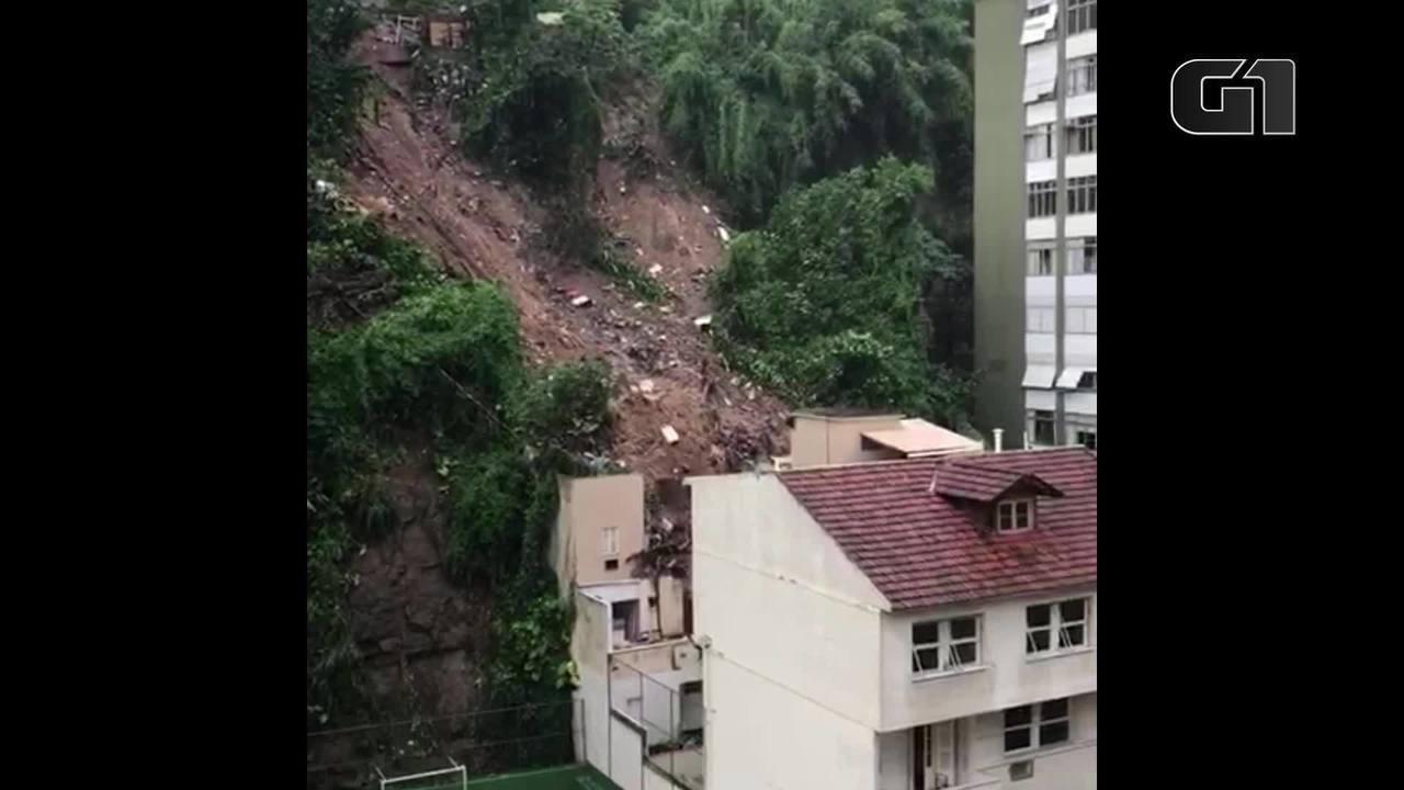 Momento em que terra desliza atrás de prédios em Ipanema